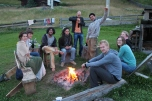 Friends and guests around the campfire